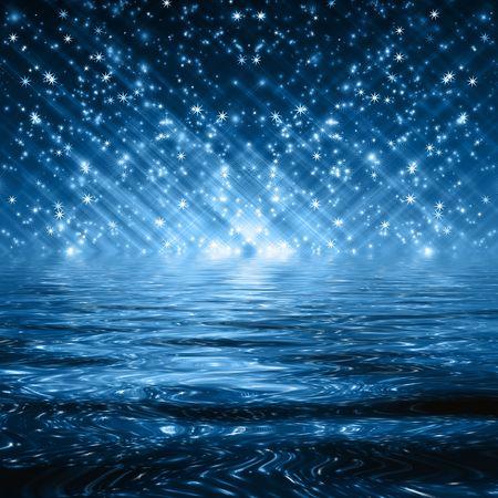 flocons de neige et les étoiles décroissant sur un chemin de lumière bleue