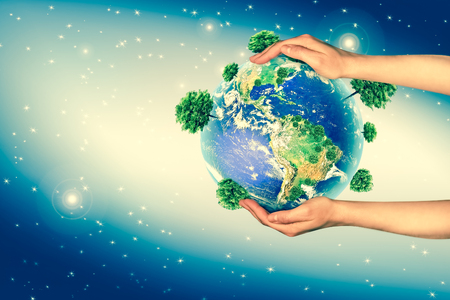 Ecological concept of the environment with the cultivation of trees on the ground in the hands. Planet Earth. Physical globe of the earth.  3D illustration.