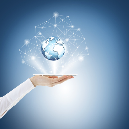 Best Internet Concept of global business from concepts series. Touch screen, hands, globe. Phone on the palm, currency icons, lines, links, connect Reklamní fotografie
