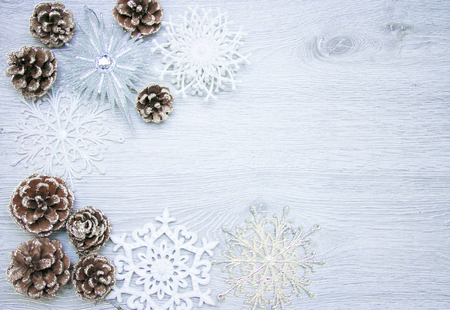Christmas and New Years composition. The pine cones, spruce branches on a wooden white background, top view