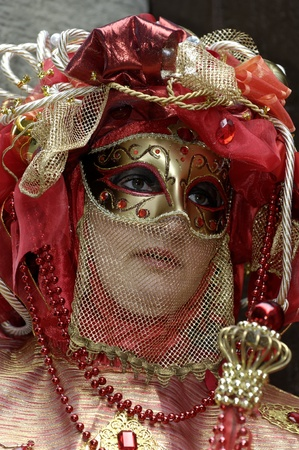 Venetian Carnival Mask - A portrait of one of the most beautiful masks photographed in open street during venetian carnival. Stock Photo