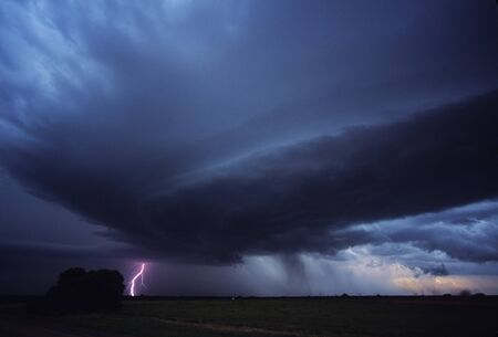 gust: Lightning strikes over Western Oklahoma as a severe storm gust front moves in. Stock Photo