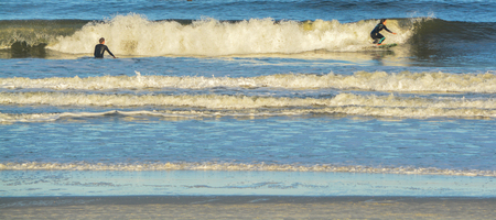 Surfers in the Atlantic, Jacksonville Beach, Duval County, Florida Stock Photo
