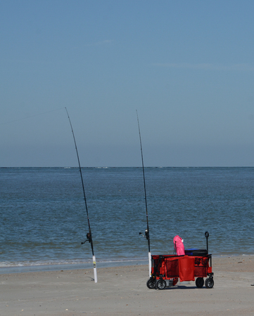 Fishing poles on Fernandina Beach, Cumberland Sound, Fort Clinch State Park, Nassau County, Florida USA
