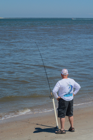 Fishing on Fernandina Beach, Cumberland Sound, Fort Clinch State Park, Nassau County, Florida USA