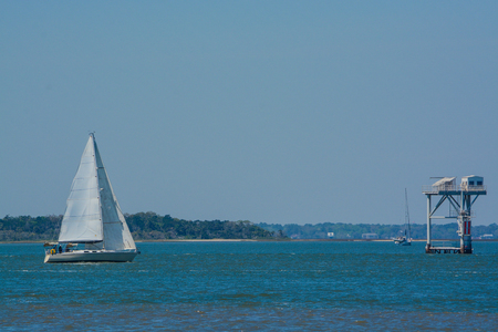 Sailboat sailing past the state line marker on Cumberland Sound. Fernandina Beach, Nassau County, Florida USA Imagens