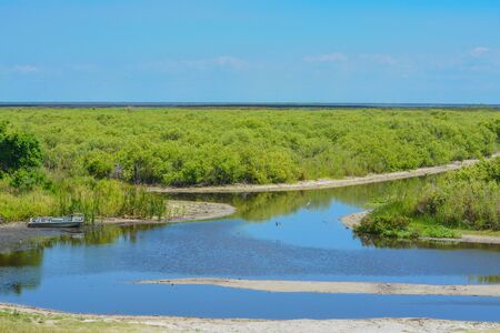 Abandoned boat in the marsh of Lake Okeechobee, Okeechobee County, Florida USA Stock fotó