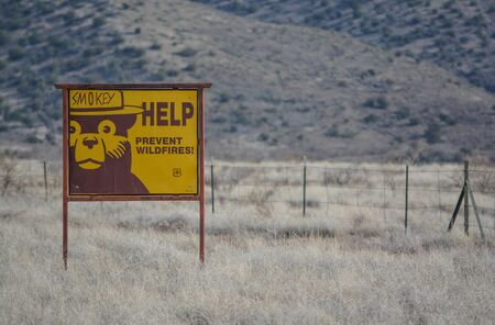 Help Smokey the Bear prevent wildfires, sign. at Camp Verde, Sonoran Desert, Coconino National Forest in Arizona