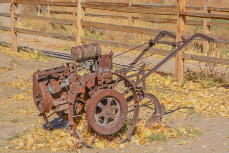 Antique walk behind gas powered tilling equipment used in the 1800's in Utah 免版税图像