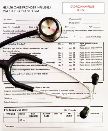 stethoscope sitting on a influenza vaccine consent form .