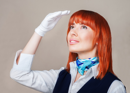 escorted: Stewardess in blue and white uniform escorted the plane in the sky Stock Photo