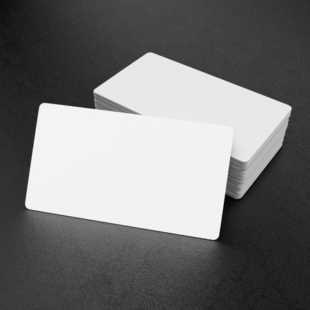 stack of business cards: Business cards on black leather background Stock Photo