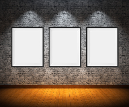art exhibition: Art gallery. Blank picture frames on brick wall background.