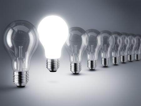 glowing light bulb: Group of lamp bulbs on black background. 3D illustration