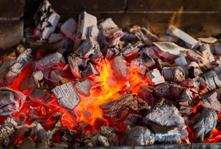 Flaming coals in the fireplace close-up