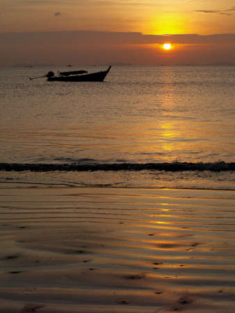 Sunset and a long tail boat in Thailand (Ko Chang west side of Thailand)
