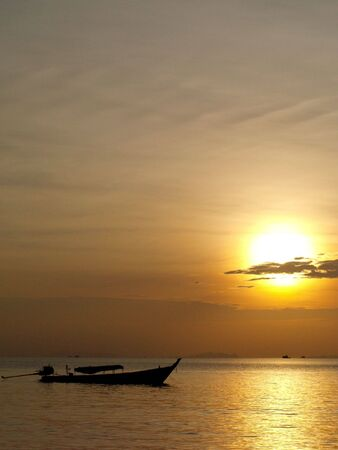 Sunset and a long tail boat in Thailand (Ko Chang west side of Thailand) Фото со стока - 4908363