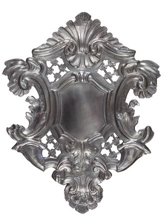 Silver historic heraldic shield with ornaments and blank field in the center.