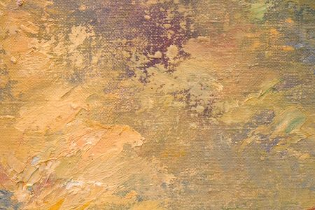 Detail of oil painted canvas in yellow, violet and blue tones.