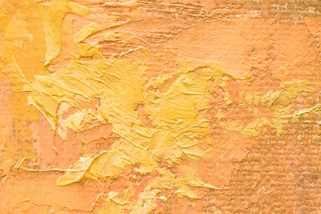 Detail of oil painted canvas in yellow and orange tones.