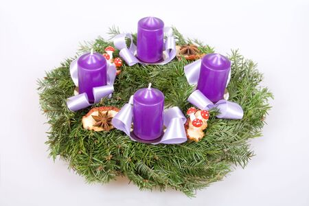 Christmas advent wreath with four violet candles.