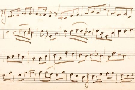 Old sheet of music score with hand-written notes.