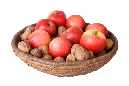 Old wicker basket with walnuts and red apples isolated on white background. Stock Photo - 2249017