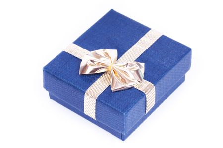 gift packs: Blue gift box for jewels with golden ribbon on white background