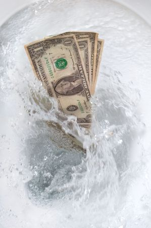 Dollar bills flushed into the toilet bowl Stock Photo - 2914850