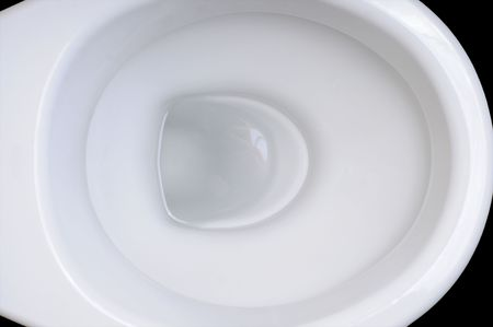 Detail of clean white toilet bowl on black background