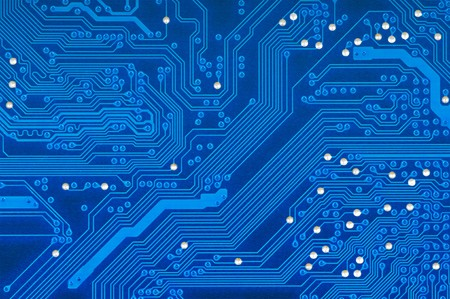 Detail of blue printed circuit board with silver studs.