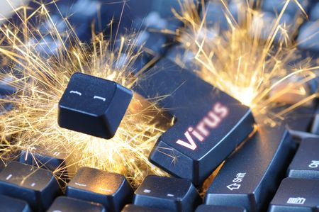 Black exploding computer keyboard with Virus button. Stock Photo