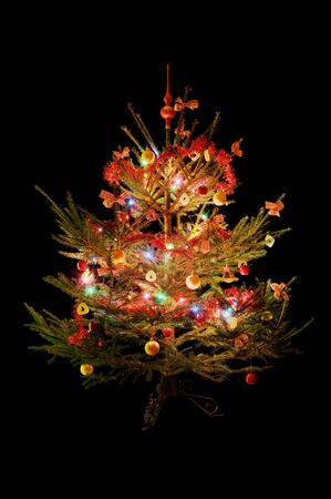 Traditional decorated Christmas tree isolated on black Stock Photo - 5608557