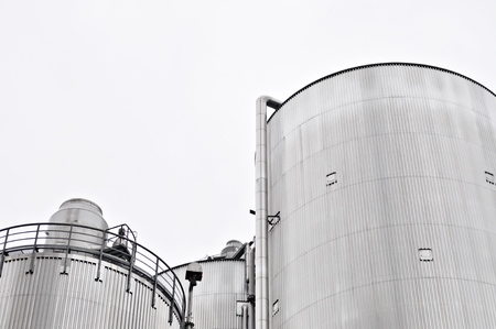 Cylindrical corrugated steel silo at a biomass power plant Stock Photo
