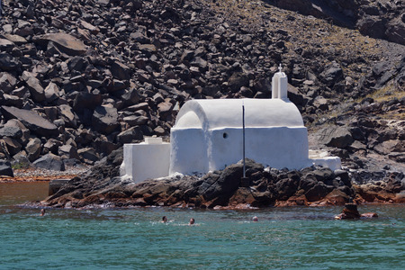 therapy geothermal: Church to hot volcanic springs  Santorini Thira Island  Cyclades Islands Stock Photo