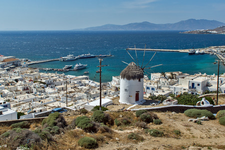 greek culture: White windmill and Mykonos town the island of Mykonos Cyclades