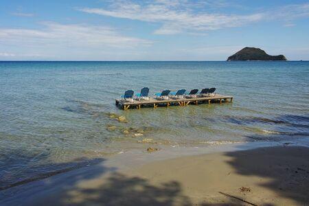 sunbeds: sunbeds in the water,  koukla beach, Zakynthos island, Greece Stock Photo
