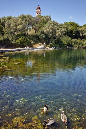 cefalonia: Reflection of church in karavomilos lake, Kefalonia, Ionian islands, Greece