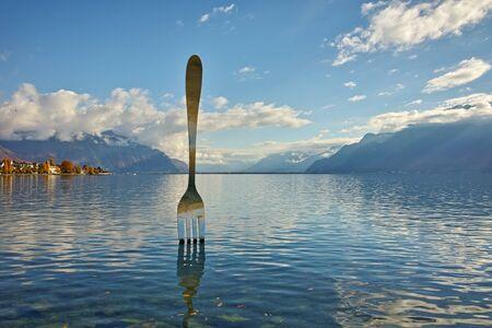 vevey: Giant steel fork in water of Geneva lake, Vevey, Switzerland Editorial