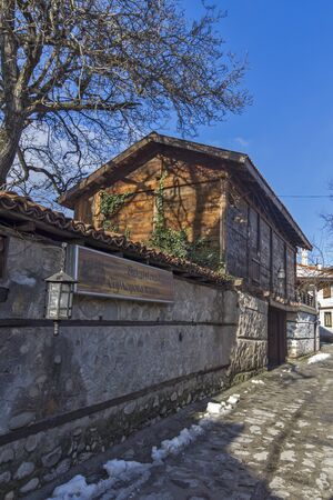 old town house: Street in old town and wooden house in Bansko,  Blagoevgrad region, Bulgaria