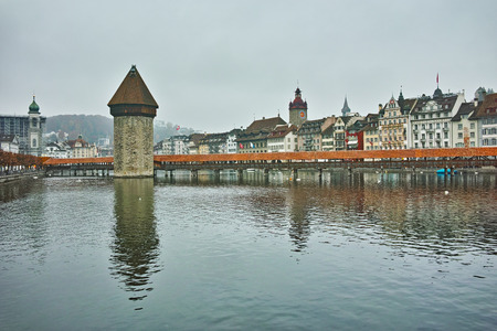 old city: foggy morning and Chapel Bridge over Reuss River, Lucerne, Switzerland Editorial