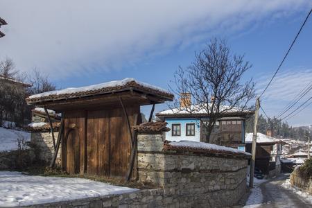 ethnographical: snowy street in historical town of Koprivshtitsa, Sofia Region, Bulgaria
