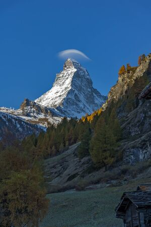 valais: Matterhorn covered with small cloud, Canton of Valais, Alps, Switzerland Stock Photo