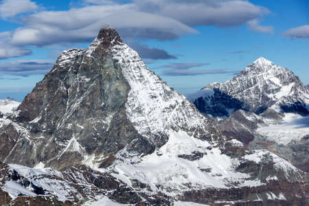 valais: Winter panorama of mount Matterhorn covered with clouds, Canton of Valais, Alps, Switzerland Stock Photo