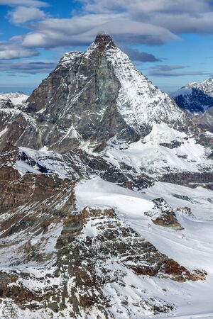 valais: Amazing panorama of mount Matterhorn covered with clouds, Canton of Valais, Alps, Switzerland