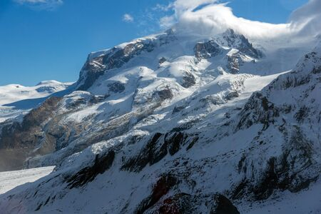 valais: clouds hanging in the Swiss Alps, Canton of Valais,  Switzerland Stock Photo