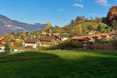interlaken: Green meadows and typical Switzerland village near town of interlaken, canton of Bern, Switzerland