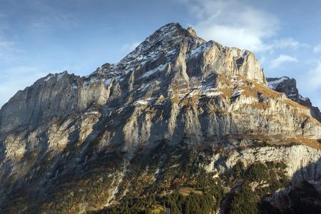 interlaken: Village of Grindelwald and mount Wetterhornin Alps near town of Interlaken, Switzerland