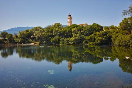 cefallonia: Reflection of church in karavomilos lake, Kefalonia, Ionian islands, Greece