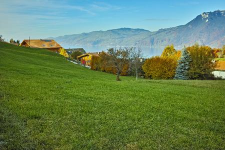 interlaken: Amazing Landscape of Lake Thun and typical Switzerland village near town of Interlaken, canton of Bern Stock Photo
